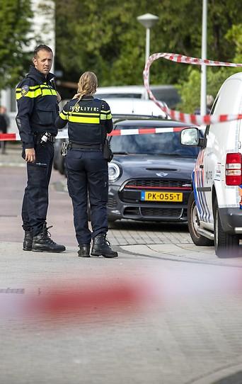 Niederländische Polizei am Tatort