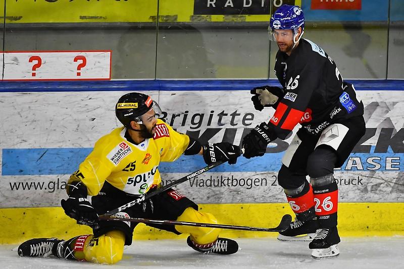 Capital player Darren Archibald and Innsbruck player Carl Mathias Porseland.