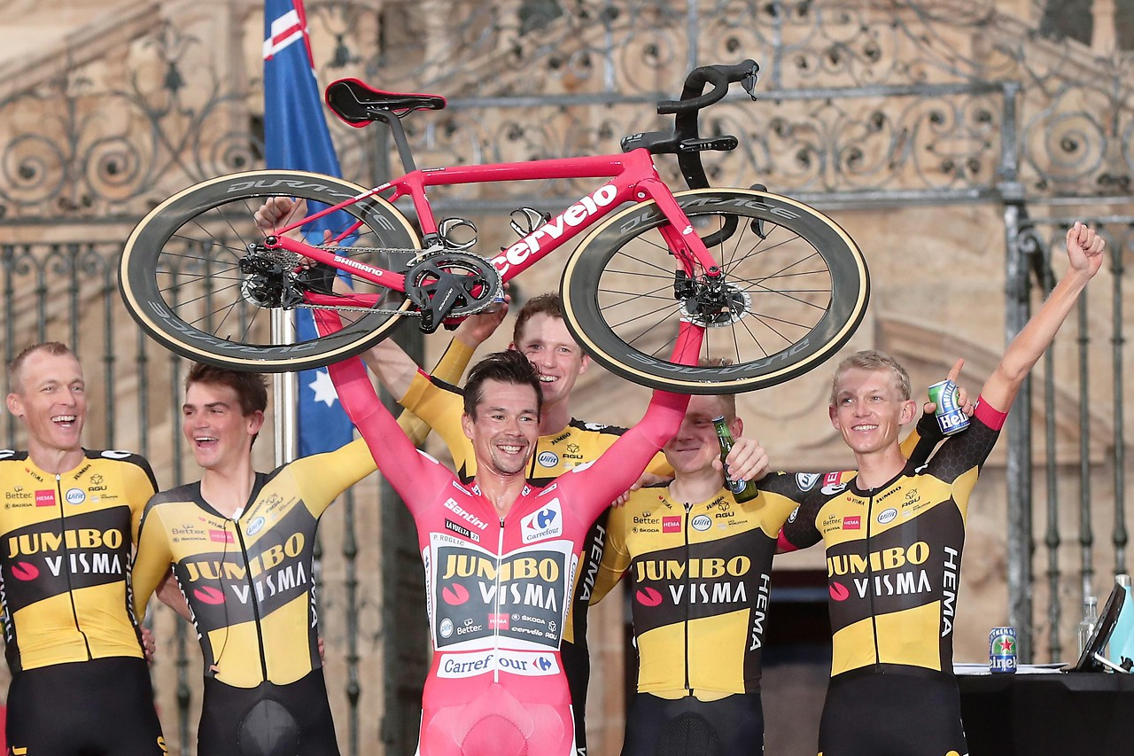 Vuelta winner Primoz Roglic celebrates together with the team